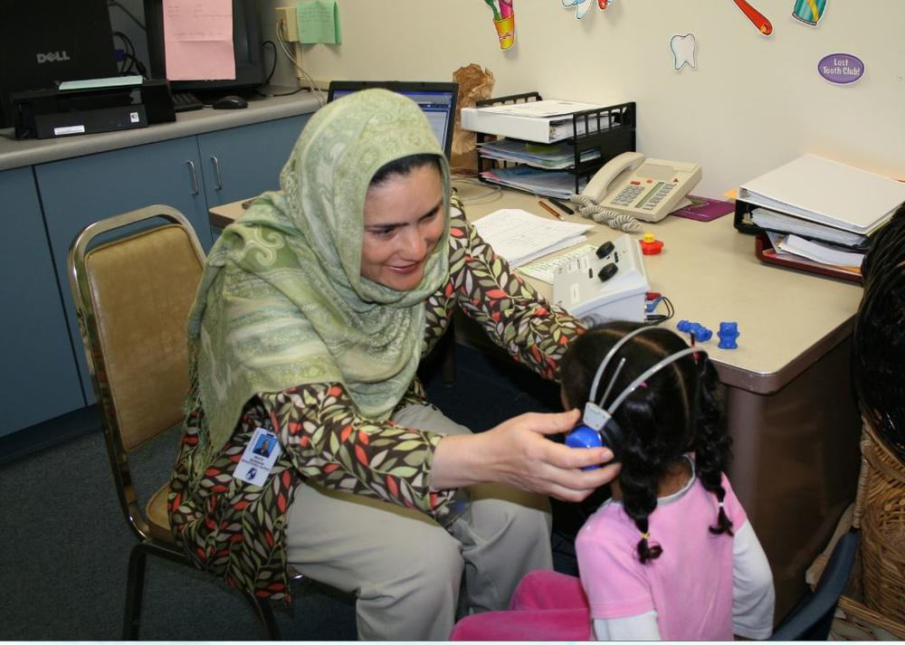 Nurse working with young child
